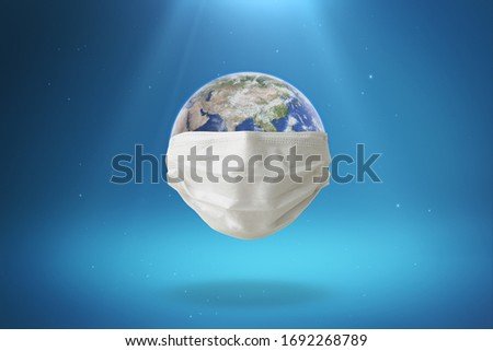The World/Earth wears a mask to prevent the spread of the virus Isolated on background with Clipping Path. 3D Illustration.