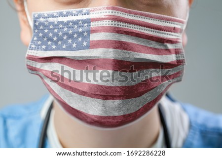 Doctor wearing protective medical textured mask,flag of The United States of America,COVID-19 Coronavirus pandemic crisis,global corona virus disease outbreak,US healthcare system illustration concept Royalty-Free Stock Photo #1692286228