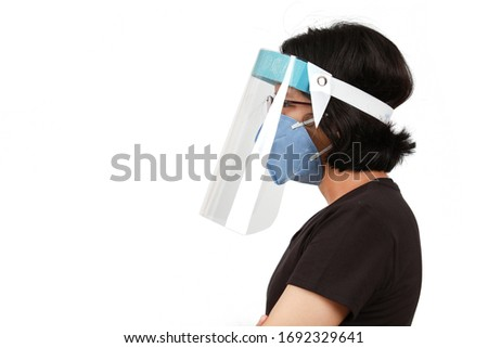 A girl wear mask and face shield to protect colona virus or Covid-19 Royalty-Free Stock Photo #1692329641