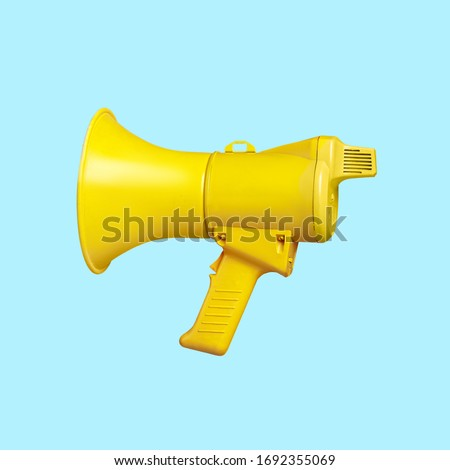 Yellow megaphone loudspeaker on a blue background