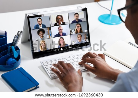 Woman Working From Home Having Group Videoconference On Laptop #1692360430