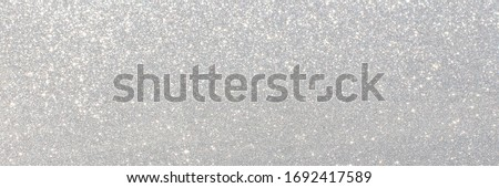 White and grey glitter bokeh circle glow blurred and blur abstract. Glittering shimmer bright luxury. White and silver glisten twinkle for texture wallpaper and background backdrop.  Royalty-Free Stock Photo #1692417589