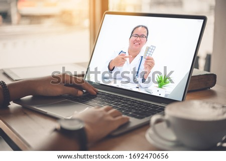 The patient's viewpoint consult with the doctor via social media such as laptop, smartphone, almost. The work for home concept of doctors and patients. #1692470656