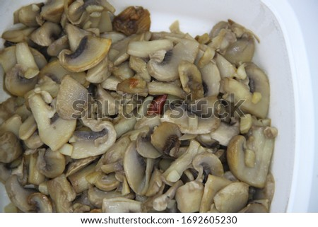 mushrooms cooked in garlic on white background #1692605230
