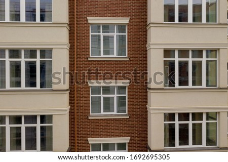 The property. New modern building with balconies, close-up, fragment. Close-up of glass balconies of modern hotel building. #1692695305
