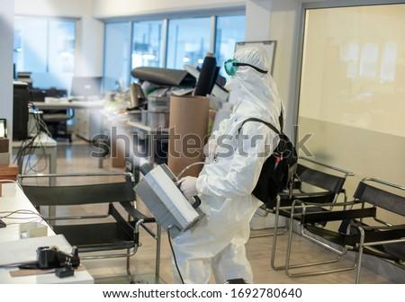 Corona spraying in office floor #1692780640
