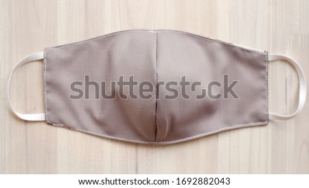 Gray colour fabric face masks cover mouth DIY craft. A protection from polluted with cotton fabric DIY projects do it yourself decoration. Royalty-Free Stock Photo #1692882043