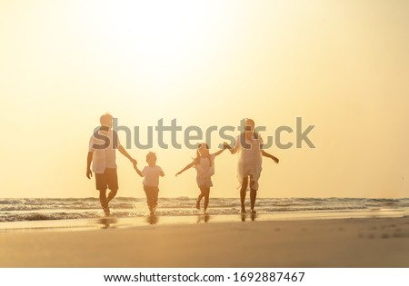 Asian family vacation at the beach with family relationships caused love and understanding to strengthen social immunity. Happy vacations holiday asian people. #1692887467
