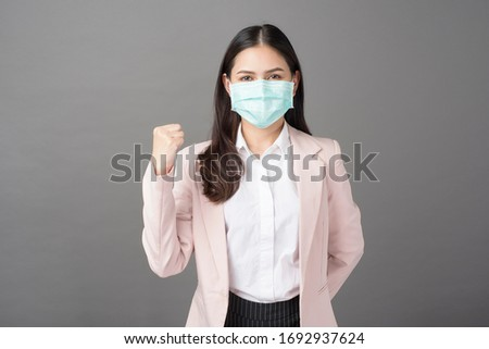 Business woman is wearing surgical mask , business protection concept  #1692937624
