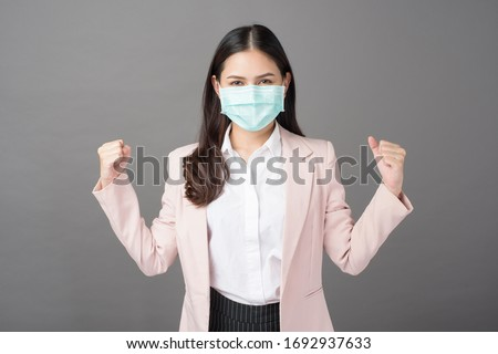 Business woman is wearing surgical mask , business protection concept  #1692937633