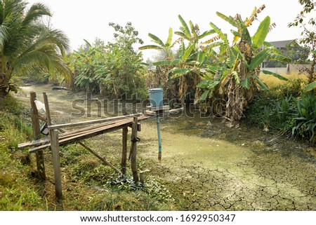 this pic show the earth pond is dry from a drought crisis, this is pond in aquaculture farm in Thailand