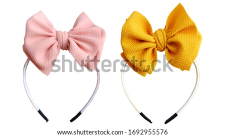 No flap bow hair with yellow and peach pastel color, so elegant and fashionable. This vintage hair band is for hair accessories headband girl. Royalty-Free Stock Photo #1692955576