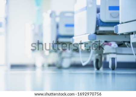 Blurred hospital images, Patient bed in the hospital, Hospital cleaning, Hospital disinfection cleaning, Patient bed cleaning for emergency patients. Royalty-Free Stock Photo #1692970756
