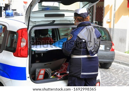 Pagani,Sa,Italy - March 29,2020 :Local police officers carry out checkpoints for people in circulation to see if they have the self-certification required by the Italian government decree for covid-19 #1692998365