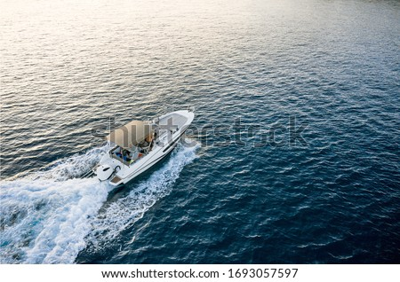 Speed boat in mediterranean sea, aerial view Royalty-Free Stock Photo #1693057597