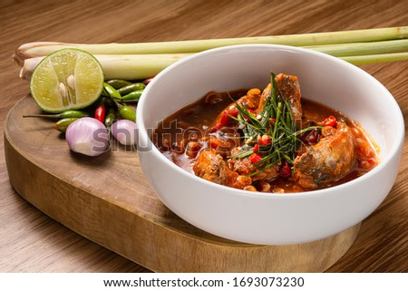 Thai food made from canned fish and  herb on wood cutting board #1693073230