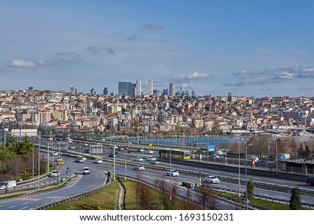 Istanbul, Turkey - February 12, 2020: Ayvansaray intersection in front of Halich Bridge over Golden Horn with the Beyoglu district in the background. #1693150231