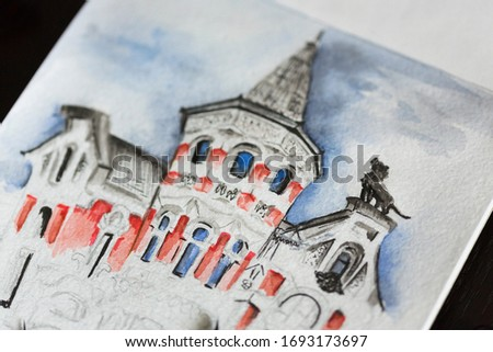 Watercolor picture or illustration or sketch of old red brick house or small castle with turret, many windows and sculpture of a lion on the roof