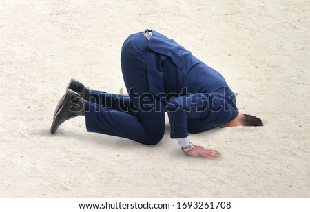 Businessman hiding his head in sand escaping from problems Royalty-Free Stock Photo #1693261708