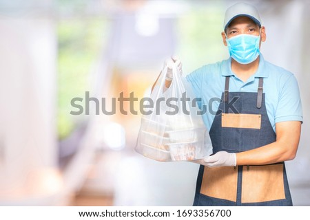 Asian food delivery man wear mask and gloves for cleanliness and hygiene,protect for pandemic and outbreak covid-19 or corona virus, use delivery service in social distancing  and quarantine.   #1693356700