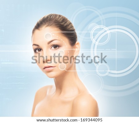 Close-up portrait of young, fresh and natural woman with the dotted arrows (spa, surgery, face lifting and make-up concept) #169344095