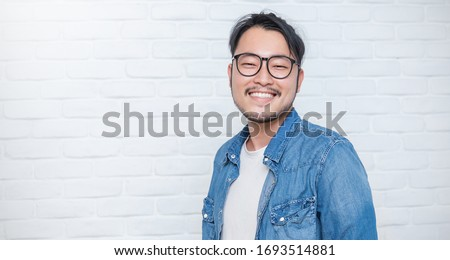Attractive beautiful positive asian man, close up portrait asian nerdy man face. Handsome nerd Japanese 30s asia guy wearing glasses with big smile isolated on white background.