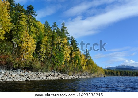 autumn wild river. Blue sky and fresh water landscape #1693538215