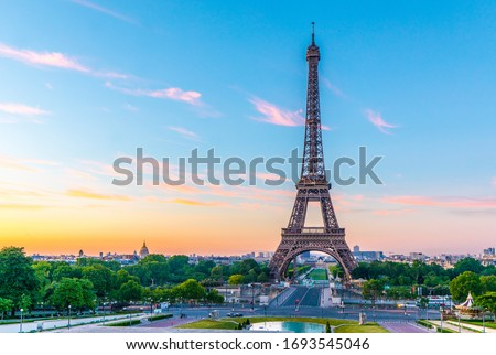 Early morning shot of the Eiffel Tower at sunrise on the River Seine in Paris, France Royalty-Free Stock Photo #1693545046