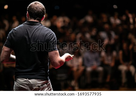 Speaker giving a talk on corporate Business Conference. Audience at the conference hall. Business and Entrepreneurship event. Royalty-Free Stock Photo #1693577935