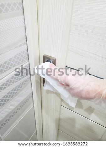 Disinfection of door handles to prevent the spread of coronavirus, pandemics. #1693589272