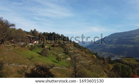 """A wonderful view over the Eisacktal valle with an old farm house on the left. The picture was taken along the """"Keschtnweg"""" over Brixen/Bressanone in Südtirol/Italy"""