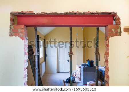 Building construction work in UK residential property with new wall opening   #1693603513