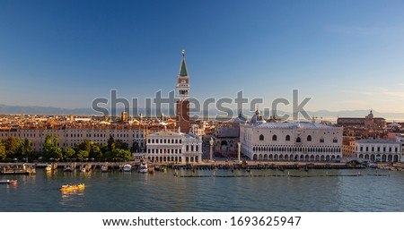 View of the Doge's Palace, Campanile, St. Mark's Basilica and St. Mark's Square from the deck of a cruise ship #1693625947