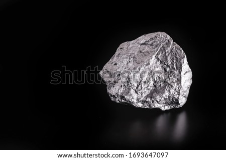 large silver stone, rare silver nugget. Gemstone in high resolution, luxury concept. Mexico ore excavation. Royalty-Free Stock Photo #1693647097