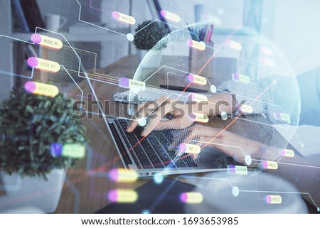 Double exposure of woman hands working on computer and world map hologram drawing. International technology business concept. #1693653985