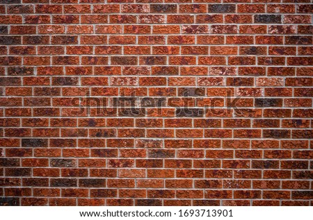 Brick wall of red color. 1000 of bricks of Brown and Grey color. Modern  brick wall for background. Old red brick walled. Part of a red brick wall. Perfect wall for for web and print or photos. #1693713901