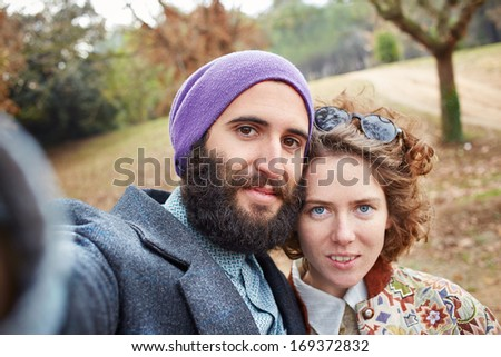 Selfie of a young hipster couple outdoors