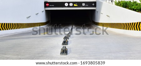 Underground parking entrance with ENTRY sign and arrow #1693805839
