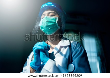 doctor in PPE suit uniform has stress and pray in Coronavirus outbreak or Covid-19, Concept of Covid-19 quarantine.Emotional stress of overworked doctor and medical care team during covid-10 period.  #1693844209