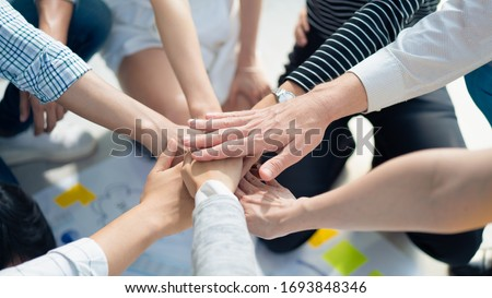 volunteer hand stack people to show teamwork spirit togetherness, Concept community of charity people volunteering with social to achievement in the future, Group of people participation of charity. #1693848346