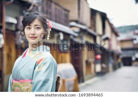 Young asian woman wearing kimono. Japanese traditional clothes. Royalty-Free Stock Photo #1693894465