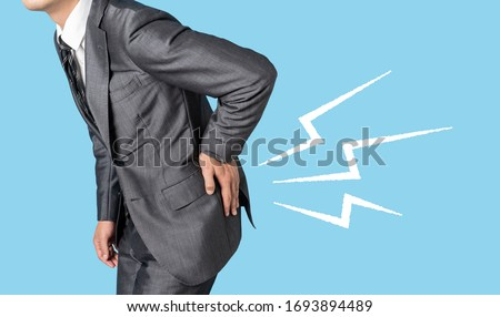 low back pain, strained back, slipped disk, medical abstract concept