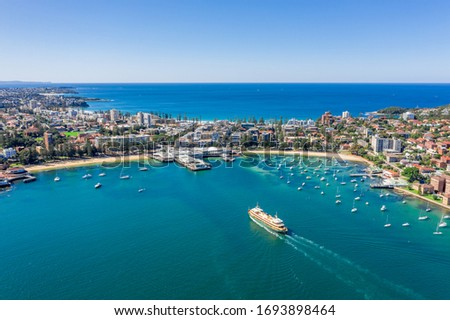 Aerial view on famous Manly Wharf and Manly, Sydney, Australia. View on Sydney harbourside suburb from above. Aerial view on Sydney North Harbour, Manly and Manly Wharf. #1693898464