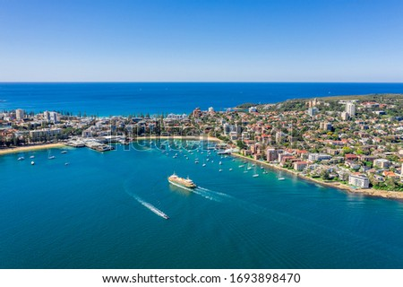 Aerial view on famous Manly Wharf and Manly, Sydney, Australia. View on Sydney harbourside suburb from above. Aerial view on Sydney North Harbour, Manly and Manly Wharf. #1693898470