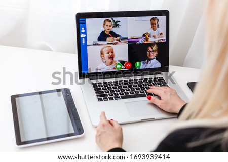 Woman video conferencing with tutor on laptop at home. Distance education concept. #1693939414
