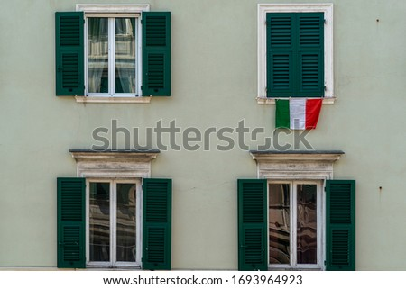 italian flag on window during coronavirus quarentine in genoa Italy #1693964923
