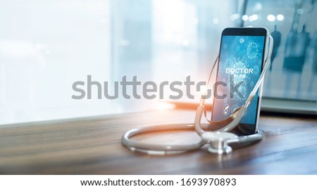Doctor through the smartphone screen, Doctor online, Online medical communication with patient and analysis health on virtual interface, Online and medical consultation, Virtual hospital, Covid-19  #1693970893