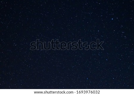 Long exposure night photo of a bright stars. A lot of stars with constellations. Far from the city. Night landscape. #1693976032