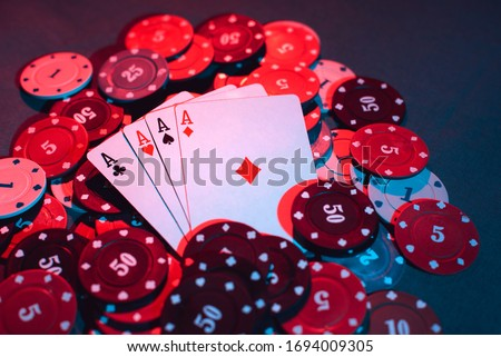 playing chips and playing cards close-up. the view from the top Royalty-Free Stock Photo #1694009305
