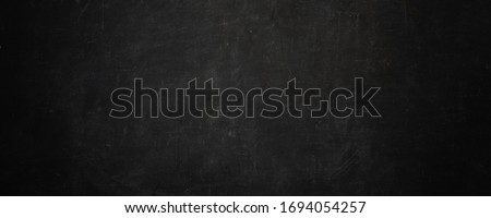 dark texture chalk board and grunge black board banner background Royalty-Free Stock Photo #1694054257